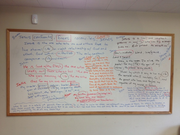 Whiteboard covered with text describing Jesus